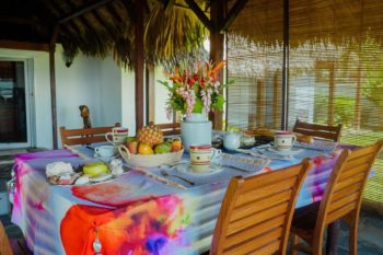 dining table (breakfast) of the villa Madirokely House in Nosy be